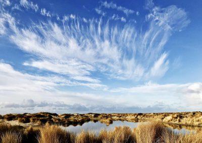 Wat een lucht boven de duinpannetjes van de Hors Texel